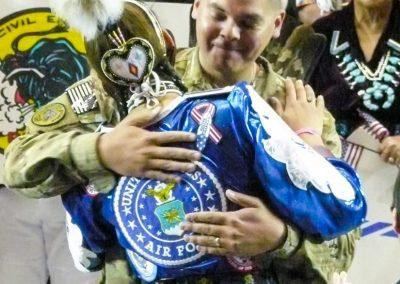 military captain hugging woman
