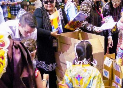 women helping children