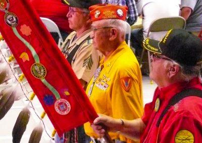 Veterans holding banner