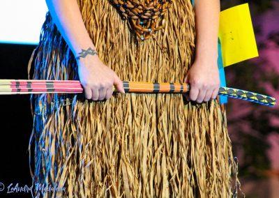 Woman Holding Sticks
