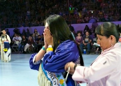Miss Indian World being given a sash