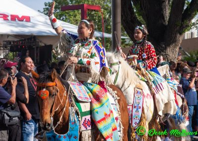 woman and girl on horses