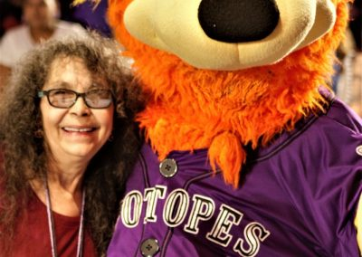 woman with Isotopes mascot
