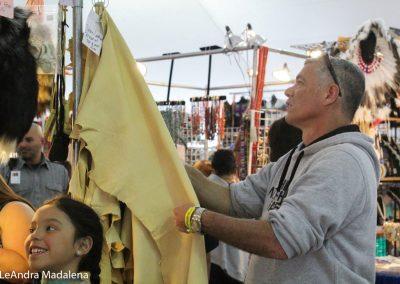 Man looking at fabric