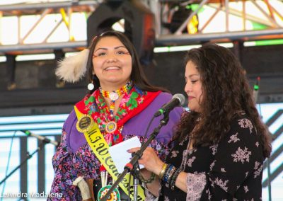 Miss Indian World contestant and the presenter talking