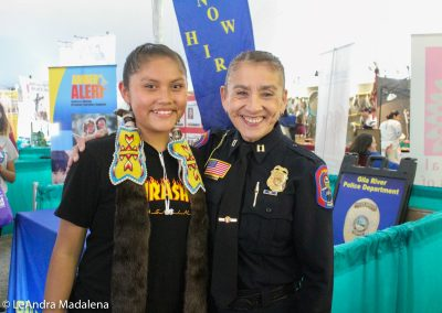 Police woman smiling with girl