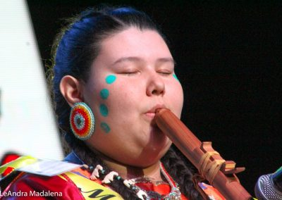 Miss Indian World contestant playing flute