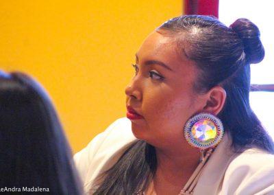 woman listening to Miss Indian World speak