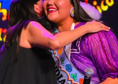 Miss Indian World hugging presenter