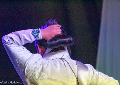 Miss Indian World contestant tying her hair