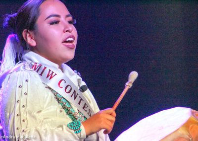 Miss Indian World contestant playing the drum