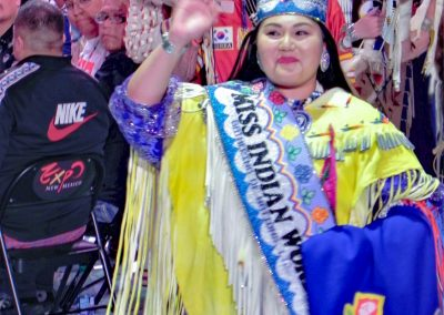 Miss Indian World waving