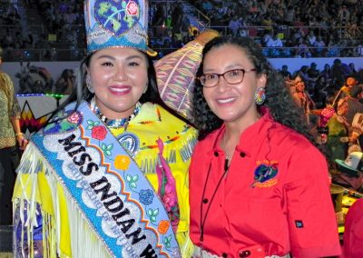 Miss Indian World smiling with participant