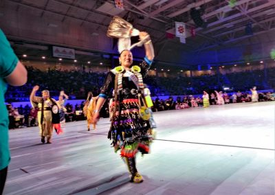 Miss Indian World contestant walking and waving to crowd