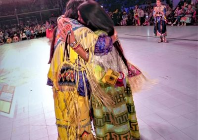 Miss Indian World hugging last year's Miss Indian World
