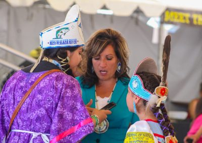 woman talking with two girls from Gathering of Nations