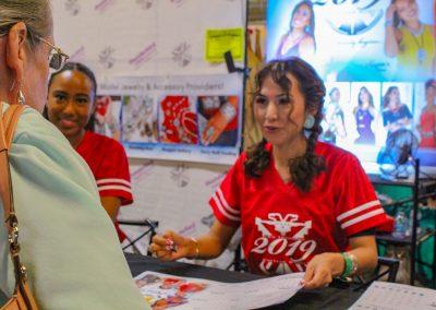 Girls helping customer