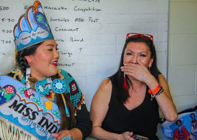 Miss Indian World talking with someone