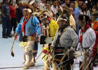 men walking to center stage