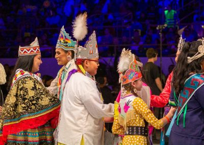 Women and Children shaking hands at Gathering of Nations