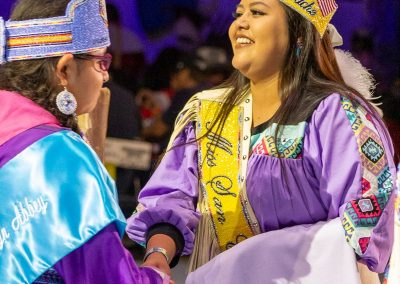 Miss Indian World shaking hands