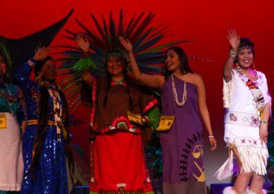 women on stage waving