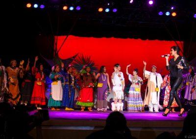 women on stage singing